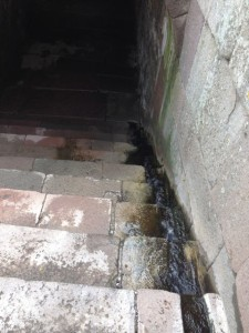 Spring water flowing into treatment tunnel.