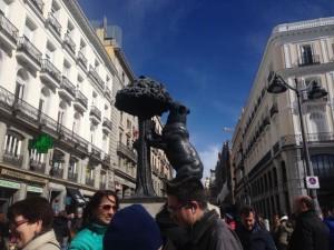 Bear eating fruit of madder tree, one of the symbols of Madrid.
